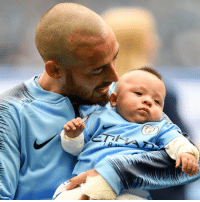 Manchester City midfielder David Silva's son stole the show when his dad carried him on to the pitch at the Etihad Stadium before today's match with Huddersfield. Tap the link in our bio 👆 to find out more about Mateo who was born prematurely in December 2017. He spent the first five months of his life in hospital and was finally given the all-clear to go home in May. He certainly bought his dad some luck - Silva scored in the 6-1 victory. 📸 Picture: Michael Regan-Getty Images. manchestercity davidsilva @david21lva football baby mascot bbcnews: Manchester City midfielder David Silva's son stole the show when his dad carried him on to the pitch at the Etihad Stadium before today's match with Huddersfield. Tap the link in our bio 👆 to find out more about Mateo who was born prematurely in December 2017. He spent the first five months of his life in hospital and was finally given the all-clear to go home in May. He certainly bought his dad some luck - Silva scored in the 6-1 victory. 📸 Picture: Michael Regan-Getty Images. manchestercity davidsilva @david21lva football baby mascot bbcnews