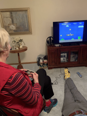 """Christmas, Grandma, and Nintendo: MAR  00o  NORLD TIME My Grandma asked for a Classic Nintendo for Christmas because she read that playing will, """"improve her memory."""""""