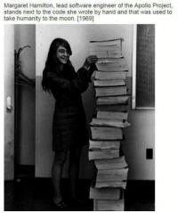 Memes, Apollo, and 🤖: Margaret Hamilton, lead software engineer of the Apollo Project,  stands next to the code she wrote by hand and that was used to  take humanity to the moon. [1969] Amazing