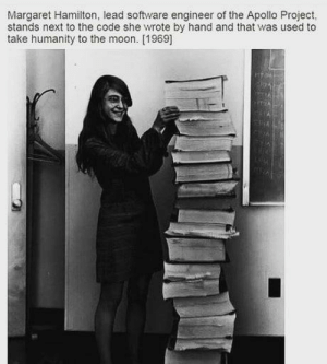 Coding in those days.: Margaret Hamilton, lead software engineer of the Apollo Project,  stands next to the code she wrote by hand and that was used to  take humanity to the moon. [1969] Coding in those days.