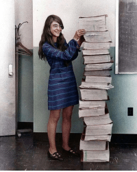 Margaret Hamilton, NASAs lead software engineer for the Apollo Program, stands next to the code she wrote by hand that took Humanity to the moon in 1969.: Margaret Hamilton, NASAs lead software engineer for the Apollo Program, stands next to the code she wrote by hand that took Humanity to the moon in 1969.