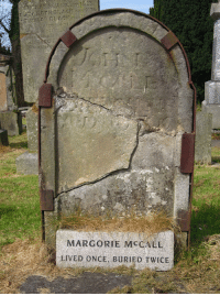 "Alive, Bitch, and Children: MARGORIE MCCALL  LIVED ONCE, BURIED TWICE lord-kitschener: harokissmile:  ksteeno:  spoookyscary:  After succumbing to a fever of some sort in 1705, Irish woman Margorie McCall was hastily buried to prevent the spread of whatever had done her in. Margorie was buried with a valuable ring, which her husband had been unable to remove due to swelling. This made her an even better target for body snatchers, who could cash in on both the corpse and the ring. The evening after Margorie was buried, before the soil had even settled, the grave-robbers showed up and started digging. Unable to pry the ring off the finger, they decided to cut the finger off. As soon as blood was drawn, Margorie awoke from her coma, sat straight up and screamed. The fate of the grave-robbers remains unknown. One story says the men dropped dead on the spot, while another claims they fled and never returned to their chosen profession. Margorie climbed out of the hole and made her way back to her home. Her husband John, a doctor, was at home with the children when he heard a knock at the door. He told the children, ""If your mother were still alive, I'd swear that was her knock."" When he opened the door to find his wife standing there, dressed in her burial clothes, blood dripping from her finger but very much alive, he dropped dead to the floor. He was buried in the plot Margorie had vacated. Margorie went on to re-marry and have several children. When she did finally die, she was returned to Shankill Cemetery in Lurgan, Ireland, where her gravestone still stands. It bears the inscription ""Lived Once, Buried Twice.""  what did i just read  Irish women are strong as fuck   ""I lived, bitch"" irl"