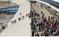 Memes, Police, and Riot: Mario Tama/Getty Images Migrants climb up a bank of the nearly dry Tijuana River as they make their way around a police blockade toward the El Chaparral port of entry on Sunday in Tijuana, Mexico. U.S. Customs and Border Protection temporarily suspended northbound and southbound crossings for both pedestrians and vehicles at the San Ysidro port of entry after hundreds of migrants pushed past Mexican riot police and rushed the U.S. border.
