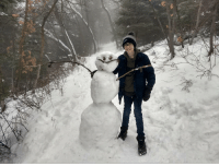 Me and my lil bro built a snowman on a trail to brighten everyones day: Me and my lil bro built a snowman on a trail to brighten everyones day