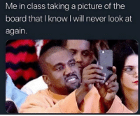 Taking A Picture: Me in class taking a picture of the  board that I know I will never look at  again.
