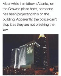 Apparently, Police, and Hotel: Meanwhile in midtown Atlanta, on  the Crowne plaza hotel, someone  has been projecting this on the  building. Apparently, the police can't  stop it as they are not breaking the  law. :0