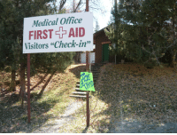 """Being Halloween, this Boy Scout camp medical office sign seems especially ominous (sign is the year-round sign).: Medical Office  FIRST AID  Visitors """"Check-in"""" Being Halloween, this Boy Scout camp medical office sign seems especially ominous (sign is the year-round sign)."""