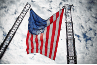 An American flag flies between ladders at the annual Hero Thrill Show, an event in Philadelphia which raises money for children of fallen first responders.: Michael Candelori/Sipa USA/AP Images An American flag flies between ladders at the annual Hero Thrill Show, an event in Philadelphia which raises money for children of fallen first responders.