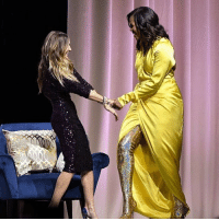 Michelle Obama stuck to her motto during an event in NYC with Sarah Jessica Parker - when others go low, she's going high ... as in super thigh-high boots and a matching slit in her gown. tmz michelleobama sjp sarahjessicaparker balenciaga nyc becoming: Michelle Obama stuck to her motto during an event in NYC with Sarah Jessica Parker - when others go low, she's going high ... as in super thigh-high boots and a matching slit in her gown. tmz michelleobama sjp sarahjessicaparker balenciaga nyc becoming