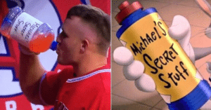 Mike Trout in the dugout drinking out of a Space Jam Inspired bottle.: Mike Trout in the dugout drinking out of a Space Jam Inspired bottle.