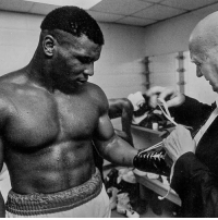 "Boxing, Fire, and Gym: @MikeTyson left behind a turbulent young life when at age 14, he moved upstate from Brooklyn to Catskill, N.Y., where he trained at Cus D'Amato's legendary boxing gym. It was the early 1980s, Kid Dynamite was a kid from the streets of Brooklyn, he had that comical high-pitched voice and accompanying lisp, dabbled in pigeons and put the Catskills on the map as some hallowed place on earth, where - that legendary trainer - an old sage, Cus D'Amato, transformed troubled boys into supermen. Those long days at the Catskill gym moulded that troubled boy into a human wrecking ball that made everybody before him seem outdated, like relics of the old days — things that were invented for him to tear through. Who knew that this young Kid Dynamite would soon dominate boxing as the Baddest Man On The Planet?... - Cus knew. - ""A boy comes to me with a spark of interest, I feed the spark and it becomes a flame. I feed the flame and it becomes a fire. I feed the fire and it becomes a roaring blaze."" – Cus D'Amato _________________________________ New Catskills Thermal is available now. Link in Bio RootsofFight KnowYourRoots KidDynamite BMOTP"