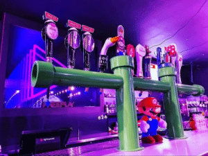A new Arcade Bar in my city has Super Mario pipes as their draught lines: Mill St.  mill St.mill Se  nda  GOO  SLA  AREEPLAY  lightspeed A new Arcade Bar in my city has Super Mario pipes as their draught lines