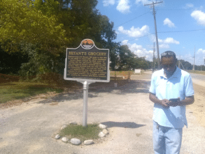 """Had an eye opening day on a real Civil Rights tour. This is the store Emmett Till allegedly whistled at a white woman at. All the grass around it, and a future """"gift shop"""" next door is maintained, but this store is hidden and allowed to decay. It is all owned by a juror that acquitted his killers.: MISSISSIPPI  FREEDOM  TRAIL  BRYANT'S GROCERY  Foartoom-year-ola Emmett Til came to this site  to bay candy tn Angest 1955. White shopkeeper  Carolya Bryant accmsed the blact youth of  itrtng ith her. and shortiy thereafter, Tilm  an ebdncted by Bryant's husband end his half  brother Till's tortared body as later found in  the Tatlahatohte Rirer. The twro men were tried  6d acqattted but later sold their murder  conferston to Look magazine. Til's death received  Amternattonal attention and to widely credited  wtth sparktng the Amertcan Ctvil Rights Movement. Had an eye opening day on a real Civil Rights tour. This is the store Emmett Till allegedly whistled at a white woman at. All the grass around it, and a future """"gift shop"""" next door is maintained, but this store is hidden and allowed to decay. It is all owned by a juror that acquitted his killers."""