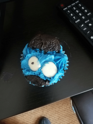 Cookie Monster, Monster, and Cookie:  #Mote PSe $Mde  3  7  GUIDE  INFO  CHL  VOL This cookie monster cupcake from a supermarket