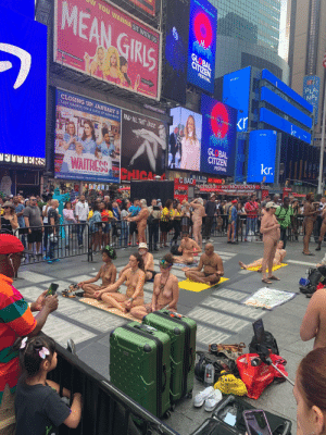 Just an ordinary day in Times Square. [NSFW]: MOVEMENT  YOU WANNA SIT WITH US  MEAN GIRIS  GLOBAL  CITIZEN  npr  PLAY  NPR  ER  FESTIVAL  Ingan  MEANGIRLSONBROADWAY.COM  n your  eaker.  FEY  MUSIC BY  JEFF RICHMOND  DAUGUST WILSON THEATRE  245 W.52ND ST  ONOCAMD  NELL BEJAMIN CASEY NHOLA  kr  POWER THE MOVEMENT  OUTFRONT PRIME  R$  CLOSING UP! JANUARY 5 AND AUL THAT JAZZ  LAST CHANCE FOR A SLICE OF HAPPINESS  SARONSK GLOBAL  SARA  BAREILLES  kr.  PRESENTS  CITIZEN  FESTIVAL  W 47 St  or De  COEO CEAVE  BLUE FIN DOS CAMIOS  WAITRESS CHICA  FOOD-SUSHI  C BAichas NYC HOTDOGS HOTDOG  BEER  THE MUSIC  PRETZELS WINE HOT DOGS  FIUERS  OC BAO  DROFT BELR WINE2 R E  THE HIT BROADWAY MUSICAL  BROOKS ATKINSON THEATRE 256 W.47TH ST. WAITRESSTHEMUSICAL.COM  C x.com uN  AMBASSADOR  DRAN D  ALA GRADSLAN M .o  45  Vet u  TOYOTA  Toyota.com  PECYCLE WSESE THIS A  AVETOT COM  2  AAV Just an ordinary day in Times Square. [NSFW]