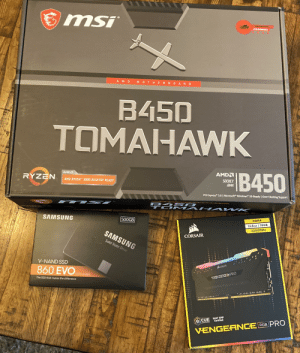 After using a prebuilt for 2 years. I've made a choice, and it's a good one. The rest come in soon and I can't wait.: msi  ARSENFL  GAMING  AMDM OTHERBO ARD  B450  TOMAHAWK  B450  AMDA  AMDA  RYZEN  SOCKET  AM4  AMD RYZEN 3000 DESKTOP READY  PCI Express 3.0 | Microsoft Windows 10-Ready | Over-Clocking Support  B45 O e  OM A H A W K  SAMSUNG  500GB  DDR4  2x8 GB 16GB  3200MHZ  SAMSUNG  CORSAIR  Solid State Drive  V-NAND SSD  CORSAIR  SATA 6 Gb/s  VENGEANCE PRO  The SSD that makes the difference  O CUE Intel XMP  Certified  VENGEANCE RGB PRO After using a prebuilt for 2 years. I've made a choice, and it's a good one. The rest come in soon and I can't wait.