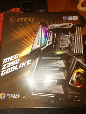 Time for upgrades boys!: msi  Intel  (intel)  SUPPORTS  CHIPSET  Z390  inside  OPTANE  MEMORY  READY  mSi  **  LGA 115X  SORRISTATOSO  MINSTALL GROCESSOR  BEFORE REMOVING COVER  SAVE AND REPLACE COVER  OF PROCESSOR IS REMOVED  REMOVE  MEG  2390  GODLIKE  MEG  EGO  SHIELD  FROZR  SHIELD  M.2 SHIELD  FROZR  MYSTIC  LIGHT  RGB  Σύδ  ON  RESET  POWER  123  ..... ****  LOTES  COREE  DDR4 BOL Time for upgrades boys!