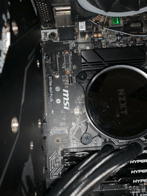 Tried installing my new 970 evo but I can't get this snubby screw to fit with the stick, it connects to my motherboard slanted and not flat, that's not supposed to happen is it? How tf does installation work with this board?: MSSR  CLR CMOS1  WH1  AUDIO1  479  : VGA_DVI1° E  S8009EE  15370)  DIMMI  DIMM2  DIMM3 FFIRS  DIMMA  15.  143  ER  HYPER  HYPER  HYPE  M597  100  16v.  * EZ Debe  CPU  DR  D12  NZXT  USB  31  MAX 10 Gb/s  20.000  1 USB2  XII  IISB1  38ADFFB7C  0 00  SYSFAN1  1541  FRAME1  Si  M2_2  PCI_E1  Z170A-G43 PLUS  M.2  PC.  AS2 Tried installing my new 970 evo but I can't get this snubby screw to fit with the stick, it connects to my motherboard slanted and not flat, that's not supposed to happen is it? How tf does installation work with this board?