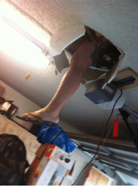 """Saw, Asking, and Crash: My brother and I were cleaning out the attic, but then I heard an """"OH SH*T!!!"""" following a loud crash and saw THIS above me. I chose to take a photo before asking questions."""
