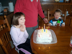 My brother crying because he cant blow out the candles. And me, not giving a fuck.: My brother crying because he cant blow out the candles. And me, not giving a fuck.
