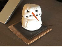 """Christmas, School, and Angry: My brother made this when he was younger in school for Christmas. It's known as """"The Angry Snowman"""" and is still put out every year with the decorations"""