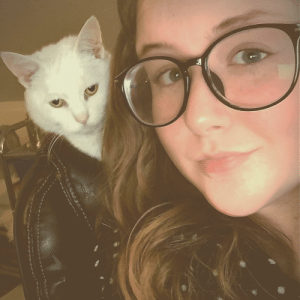 My cat sitting on the back of my chair makes it look like she's wearing a leather jacket: My cat sitting on the back of my chair makes it look like she's wearing a leather jacket