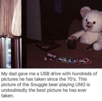 snuggle bear: My dad gave me a USB drive with hundreds of  pictures he has taken since the 70's. This  picture of the Snuggle bear playing UNO is  undoubtedly the best picture he has ever  taken.