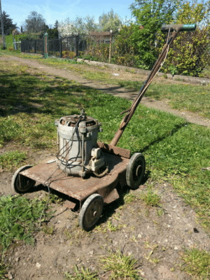 80s, Dad, and Poland: My dad made this lawnmower back in the 80s using a washing machine engine [Poland]