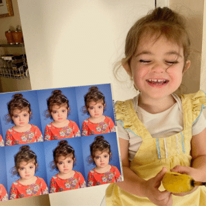 My daughter smiling only after her first ever school photos came in.: My daughter smiling only after her first ever school photos came in.