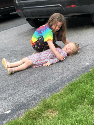 My daughters wanted to play with chalk outside. I came out to them setting up a fake crime scene.: My daughters wanted to play with chalk outside. I came out to them setting up a fake crime scene.