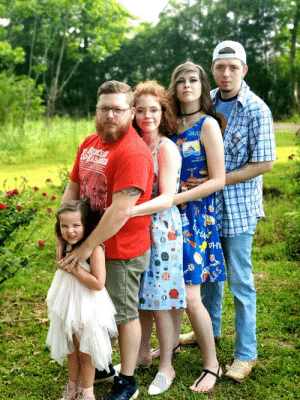 My Ex and I take Co-Parenting very seriously. Doing goofy little photo shoots like this to make our daughter smile is the happiest I have ever been. This is our mean mug Family Photo.: My Ex and I take Co-Parenting very seriously. Doing goofy little photo shoots like this to make our daughter smile is the happiest I have ever been. This is our mean mug Family Photo.