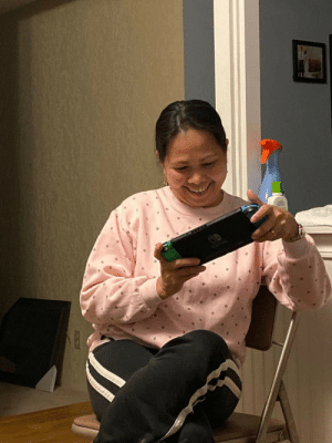 My mother-in-law came to visit from Malaysia. Here's her first experience ever playing a video game. She's hooked to Mario Kart!: My mother-in-law came to visit from Malaysia. Here's her first experience ever playing a video game. She's hooked to Mario Kart!