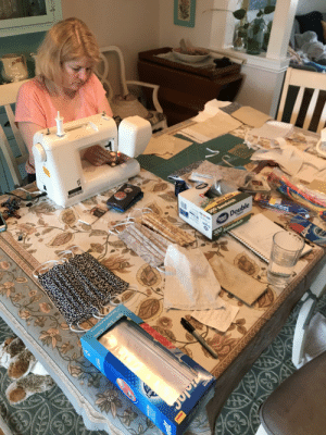 My mother making ~50 masks for various doctors and hospitals. (the pattern was given to us via Johns Hopkins so please don't say the cloth masks don't work): My mother making ~50 masks for various doctors and hospitals. (the pattern was given to us via Johns Hopkins so please don't say the cloth masks don't work)