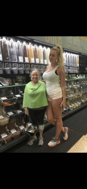 Family, Mom, and Her: My short mom sends our family photos of her with really tall people