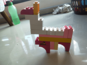 My sisters version of a gun for a ripoff Lego, the yellow at the top is meant to be a scope. It looks like a llama: My sisters version of a gun for a ripoff Lego, the yellow at the top is meant to be a scope. It looks like a llama