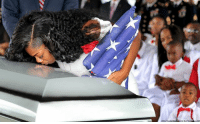 Memes, Army, and Husband: Myeshia Johnson kisses the casket of her husband, Army Sgt. La David Johnson, during his funeral service. Sgt. Johnson was one of four U.S. Special Forces killed in an ambush in Niger.