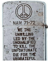 A Zippo lighter from the Vietnam War.: NAM 71-72  WE THE  UNWILING  LED BY THE  UNQUALIFIED  TO KLL THE  UNFORTUNATE  DIE FOR THE  UNGRATEFUL A Zippo lighter from the Vietnam War.