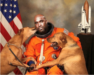 NASA Astronaut gets his official picture taken with his dogs.: NASA Astronaut gets his official picture taken with his dogs.