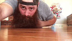 tastefullyoffensive:  Man's majestic beard magically spawns puppy. [video]: natsdor tastefullyoffensive:  Man's majestic beard magically spawns puppy. [video]