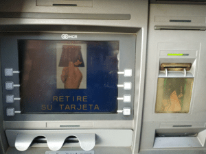 Mine, Ncr, and Now: NCR  RET IRE  SU TARJETA It thinks there's a card. Now it won't let mine in.