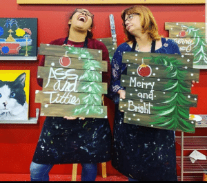 My friend and her mother really enjoyed themselves painting.: ND  ASS  ahd  Titter  Merry  and  Brisht My friend and her mother really enjoyed themselves painting.