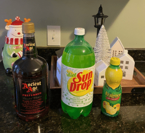 I'm feeling great tonight: neient  ge.  diet  Su  Drop  Ancient  Age.  Realemon  CITRUS SODA  PREFERRED  Blended Whiskey  Carepully blended according  to the finest cld traditions.  Twenty percent sAraight Whiskey  Erghty percent spirits distilled  Low Calorie  Naturally Flavored  Citrus Soda O  with other Natural Flavors  100%  LEMON JUICE  FROM  WITH ADDED INGRED  ONCENTRANTS  10  O2 LITERS  from the finest grains.  40% ALCAOL (EICHTY PROOF)  ENCED AND BOTTLED RY ANCIENT AGE DISTILLING Q)  T13-3722 www.bourbotutiskey.coum E-MAIL: a0EDBESDomttey.sam  NATURA  STRENG  FRANK ORT KENTLCKY  WE LOVE TO HEAR FROM OUA CUSTOMERS!  15 FL OZ (443mL) I'm feeling great tonight