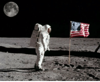 Neil Armstrong, American, and American Flag: Neil Armstrong stands next to the american flag on the moon (1969)