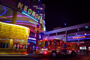 Fire, Food, and Las Vegas: NEONOO  ANY ONE  ANY ONE  ANY D  425  FREMONT ST  EXPERIENCE  E 40  Walgreens  AMERI  NTERNA  24-HR  CY  #Vega  LAS VEGAS  STIR FR  MEN  FOOD COUR  FIRE&RESCUE  ORD  1  SO CLASS  2ND  LEVEL  EWELRY  SALE  tNTECRITY  WEBAS STRIG  1633  PARAMEDIC A LVFR truck at Fremont Street, Las Vegas.