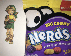 Ocarina of Time Nerd - one of my Nerd candies looks like Link's ocarina: NEW!  BIG CHEWY  NeRds  crunchy and chewy cane  NO ARTIFIC  FLAVORS  PER 21 PIECES  5mg  23, Ocarina of Time Nerd - one of my Nerd candies looks like Link's ocarina