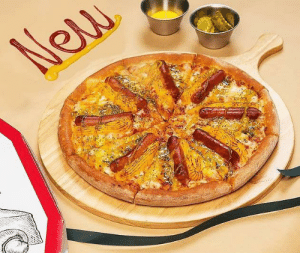 Papa John's in South Korea has debuted a new 'American Hot Dog Pizza,' which is made with eight whole hot dogs, with one fitting on every slice: New Papa John's in South Korea has debuted a new 'American Hot Dog Pizza,' which is made with eight whole hot dogs, with one fitting on every slice
