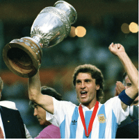 Fifa, Memes, and Oscars: ng  忍 Happy 55th birthday to Oscar Ruggeri! The solid defender lifted the FIFA World Cup in 1986 with Argentina in a team that included Diego Maradona, playing in every match. Four years later, at Italy 1990, Ruggeri and Co. failed to retain their crown as Germany beat them in the final. He also participated at USA 1994. Ruggeri lifted two Copa Americas as well as a FIFA Confederations Cup with the Albiceleste. HappyBirthday FelizCumpleaños Ruggeri WorldCup ConfedCup Argentina Albiceleste ElCabezon @afaseleccion