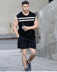 Guns, Memes, and Nick: Nick Jonas should have a license to carry those guns, right? 💪 nickjonas tmz