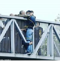 Bad, Memes, and Good: NIGEL HOWARD @Regrann from @dream3is3destiny3 - This image really got me 😢💗 A man wanting to jump off a bridge in London, tucked round by absolute strangers who proceeded to hold him for an hour until help arrived to get him down safely. Look at that grip. Look at the care, compassion, selflessness & determination shown by complete strangers to a fellow human being. There is so much more good than bad around us, just sharing a little of it. Wishing the man a full recovery. chooselife darknessintolight weareone - regrann