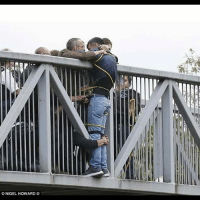 "Bad, Community, and Love: NIGEL HOWARD ""This image has really got me this morning. A man wanting to jump off a bridge in London, talked round by absolute strangers who proceeded to hold him for an hour until help arrived to get him down safely. Look at that grip. Look at the care, compassion, selflessness & determination shown by complete strangers to a fellow human being. There is so much more good than bad around us, just sharing a little of it. Wishing the man a full recovery."" unknown chooselife darknessintolight community humanrace love standup911 bethechange"